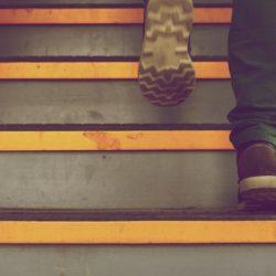 man walking up steps